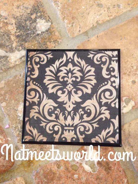 Scrapbook paper glued on tile.